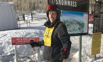veteran standing in skis and helmet