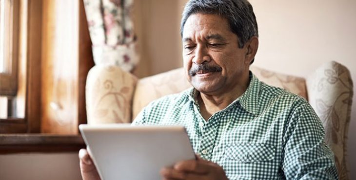 IMAGE: An older Veteran using a tablet