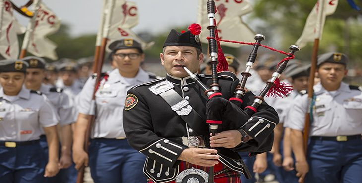 With dozens of cadets from the Mighty Eagle Junior R.O.T.C. Battalion behind him, Brownsville firefighter Desiderio Tristan plays his bagpipes as part of the marching procession that helped kickoff the start of the 2nd Annual Vietnam War Remembrance Ceremony. (U.S. Department of Veterans Affairs photo by Reynaldo Leal)