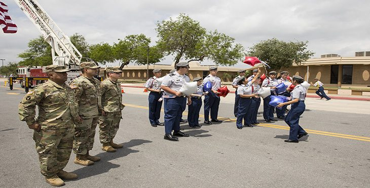 (From left to right) Army National Guardsmen Sgt. 1st Class Gamaliel Ibarrra, Staff Sgt. Jaime Esparza and Sgt. David Garcia stand guard as students from the Mighty Eagle Junior R.O.T.C. Battalion release balloons as the names of 28 fallen local Vietnam War Veterans are read. (U.S. Department of Veterans Affairs graphic by Luis H. Loza Gutierrez)