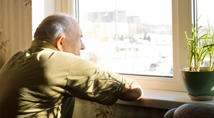 Man looking out of a window