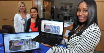 IMAGE: Pictured above: VA Open Data expert Lisa Mavrogianis (left) with Veterans Benefits staff Ritu Mishra and Rochelle Foxworth demonstrate how data can be used to tell stories, such as how process improvements helped VA reduce claims processing time.