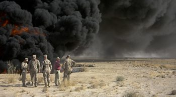 U.S. Marines with 1st Marine Logistics Group (1st MLG) burn black water aboard Taqaddum, Iraq September 22, 2008. Brig. Gen. Robert R. Ruark, Commanding General, 1st MLG, watched the event because this was the last time burning this specific black water pit before filling it in with sand. (U.S. Marine Corps photo by Sgt. Jason W. FudgeRELEASED)
