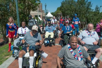 With VA employees dressed in super hero costumes, Veterans at the Charlie Norwood VA Medical Center in Augusta, Ga., participate in the 2017 VA2K Walk & Roll event. The event is held annually VA locations across the country to help promote active lifestyles and help local homeless Veterans.