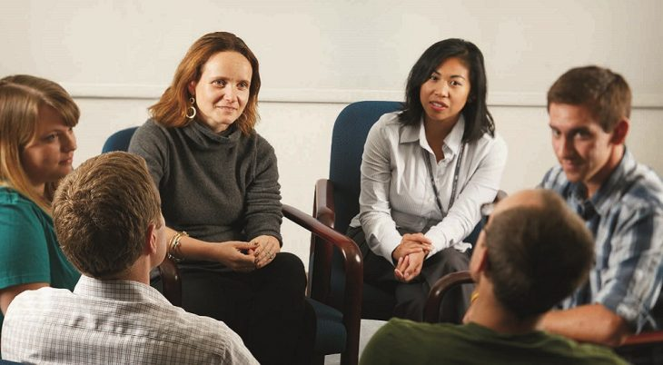 Dr. Sonya Norman, gray sweater, left, leads a meeting at the San Diego VA Medical Center regarding a talk therapy research program for Veterans who suffer from guilt and shame from deployment traumas.