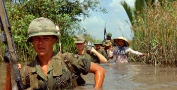 IMAGE: Pvt. Fred L. Greenleaf crosses a deep irrigation canal during an allied operation during the Vietnam War. (Photo: National Archives)