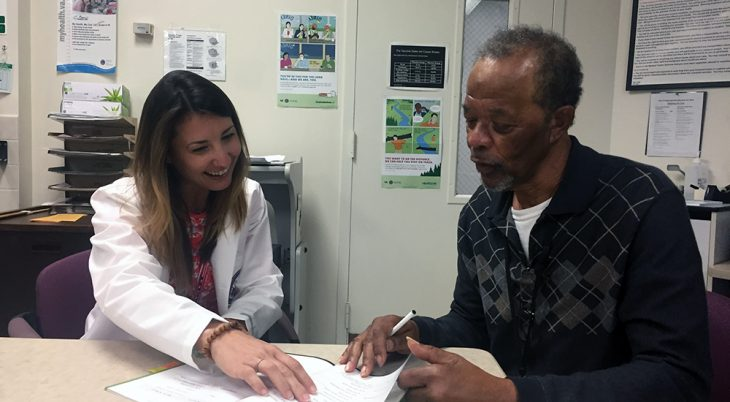 Dr. Candis Cornell discusses tobacco cessation strategies with Air Force Veteran Johnie Chattman in preparation for their next tobacco cessation session. (Photo by Melanie Thomas).