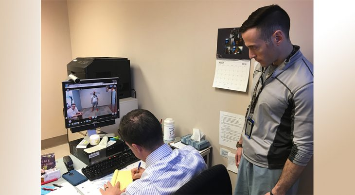 Doctor meeting with patient via computer monitor