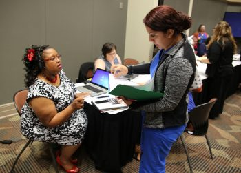 Tamara Monroe, Community Care manager for the southern region and other VA staff members assist vendors attending the vendor health care fair at the UTRGV Academic and Clinical Research Building in Harlingen, Texas, on August 9, 2018. (U.S. Department of Veterans Affairs photo by Luis H. Loza Gutierrez)
