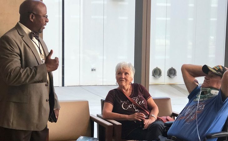 IMAGE: A VA employee talking with Veterans