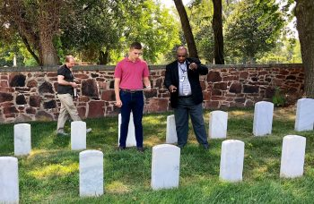IMAGE: James Sanders, center, Quantico National Cemetery Director, speaks to students from Defense Information School (DINFOS), during a site visit to Alexandria National Cemetery (ANC) July 13, 2018. DINFOS provides its students an opportunity to work with local organizations and businesses within the Fort Meade, Maryland area, to produce the student's capstone presentation.