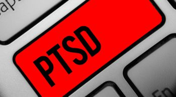 "Laptop Keyboard with key ""PTSD"" highlighted"