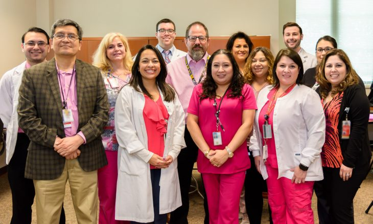 VA employees show their support for this year's Breast Cancer Awareness Month by posing for a group photo while wearing different pink garments on October 17, 2018, at the VA outpatient clinic in Harlingen,Texas. (U.S. Department of Veterans Affairs photo by Abel Flores)