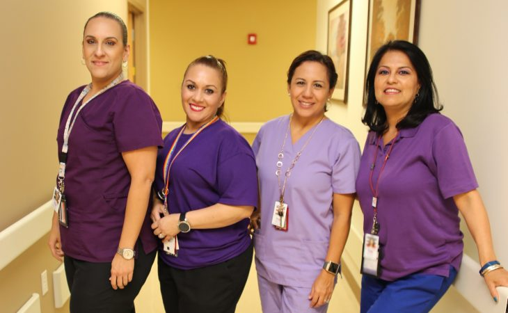 VA medical staff members pose for a group photo with purple garments on October 10, 2018, at the VA Health Care Center at Harlingen,Texas, in observance of this year's Domestic Violence Awareness and Prevention month. (U.S. Department of Veterans Affairs photo by Luis H. Loza Gutierrez)