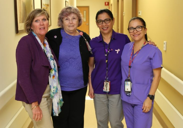 VA employees pose for a group photo with purple garments on October 10, 2018, at the VA Health Care Center at Harlingen,Texas, in observance of this year's Domestic Violence Awareness Month. (U.S. Department of Veterans Affairs photo by Luis H. Loza Gutierrez)