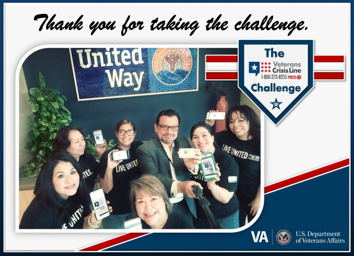 VA psychologist and suicide prevention coordinator, Dr. Rodolfo Quintana (at center) uses a selfie stick and camera phone to pose for a group photo with local members of the United Way who completed the Veterans Crisis Line (VCL) challenge during a collaborative meeting for Suicide Prevention Month, which took place September 7, 2018. (Courtesy photo by Rodolfo Quintana was used for this U.S. Department of Veterans Affairs photo illustration by Luis H. Loza Gutierrez)  Disclaimer: Any mentioning or use of the United Way and or use of their logo is strictly for news purposes only. No official federal endorsement intended or implied.