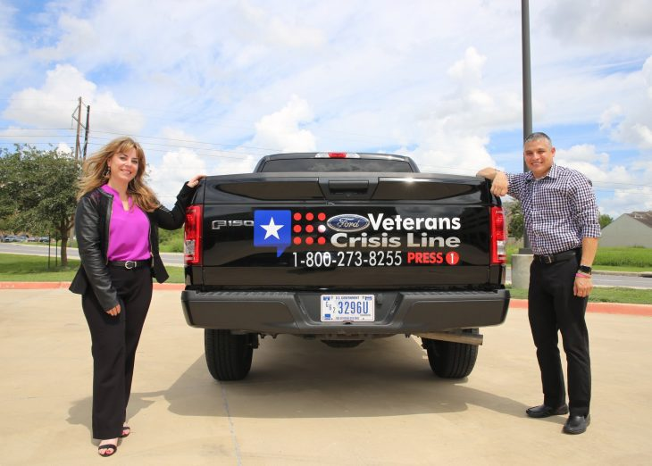 Dr. Jennifer Wood, acting deputy chief of staff for VCB and Jesse Sanchez, administrative officer for VCB mental health, pose for a photo at the sides of a pickup truck's tail gate bearing the Veterans Crisis Line (VCL) number and logo. The VCL decal display on the government owened vehicle (GOV) is part of VA Texas Valley Coastal Bend Health Care System's (VCB) observance of Suicide Prevention Month. Image taken September 17, 2018, at the VA Health Care Center at Harlingen, Texas. (U.S. Department of Veterans Affairs photo by Luis H. Loza Gutierrez)