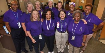 IMAGE: Pictured above: Central Arkansas Veterans Health care leadership and create a 'sea of purple' with special Intimate Partner Violence (IPV) awareness T-shirts. CAVHS employees are encouraged to wear the shirts every Friday in October to bring awareness to, and prevention of, intimate partner violence. (VA photo by Jeff Bowen.)