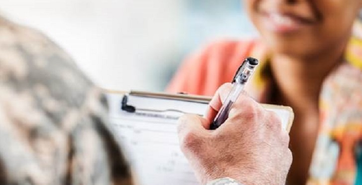 IMAGE: stock image of uniformed arm/hand taking notes