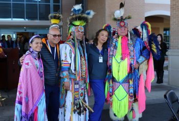 Two VA nurses pose for a group photo with members of the Lipan Apache Tribe of Texas before the start of a special event held in observance of National Native American Heritage Month, which took place at the VA outpatient clinic in Harlingen, Texas, on November 16, 2018. (U.S. Department of Veterans Affairs photo by Luis H. Loza Gutierrez)