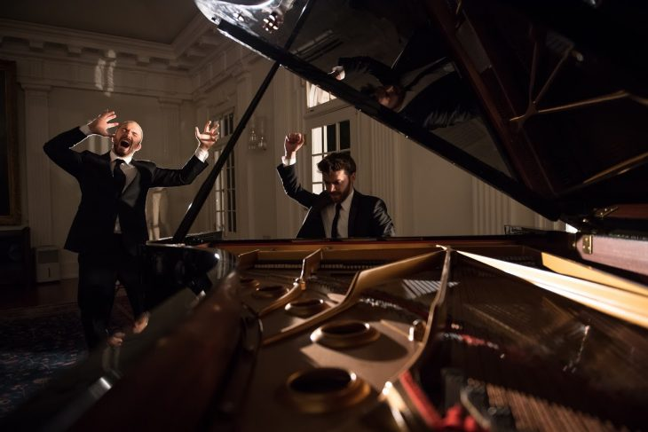 Picture shows a pianist and a singer performing