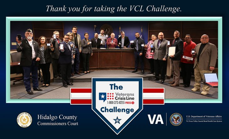 Members of VA Texas Valley Coastal Bend Health Care System (VCB), the Hidalgo County Community Service Agency and the Hidalgo County Commissioners Court pose for a group photo as a sign of solidarity in the effort to prevent suicides among service members and Veterans by displaying their phone screens as proof that they have completed the Veterans Crisis Line Challenge on November 20, 2018, at the Hidalgo County Commissioners courtroom in Edinburg, Texas. (VA photo by Reynaldo Leal used for the creation of this VA photo illustration by Luis H. Loza Gutierrez)  The Veterans Crisis Line Challenge also known as the VCL Challenge consists of a person adding the Veterans Crisis Line logo and number (1-800-273-8255, Press 1) to their phone contacts list, then posting a photo on social media of yourself showing the number on your phone.