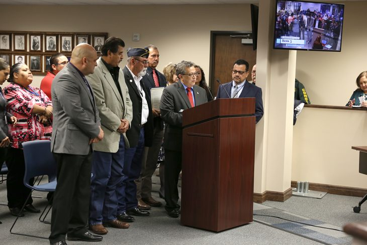 Members of VA Texas Valley Coastal Bend Health Care System (VCB) and the Hidalgo County Community Service Agency (CSA) stand as Jaime Rodriguez, Hidalgo County CSA executive director, speaks from the podium during a public hearing hosted by the Hidalgo County Commissioners Court on November 20, 2018, at the Hidalgo County Commissioners courtroom in Edinburg, Texas. (U.S. Department of Veterans Affairs photo by Reynaldo Leal)