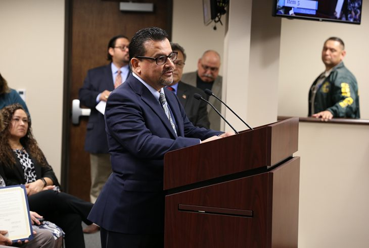 VA Texas Valley Coastal Bend Health Care System (VCB) suicide prevention coordinator, Dr. Rodolfo Quintana, speaks from the podium during a public hearing hosted by the Hidalgo County Commissioners Court on November 20, 2018, at the Hidalgo County Commissioners courtroom in Edinburg, Texas. (U.S. Department of Veterans Affairs photo by Reynaldo Leal)