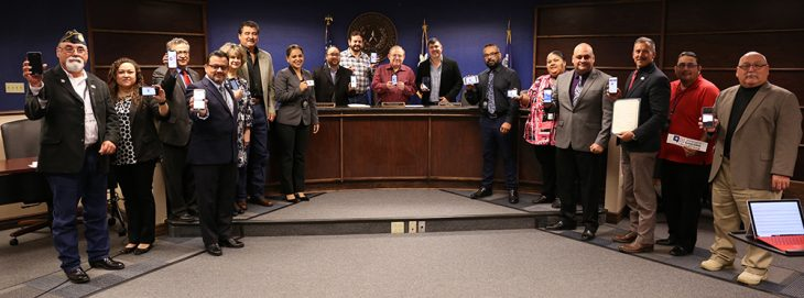 Members of VA Texas Valley Coastal Bend Health Care System (VCB), the Hidalgo County Community Service Agency and the Hidalgo County Commissioners Court pose for a group photo as a sign of solidarity in an effort to prevent suicides among service members and Veterans by displaying their phone screens as proof that they have completed the Veterans Crisis Line Challenge on November 20, 2018, at the Hidalgo County Commissioners courtroom in Edinburg, Texas. (VA photo by Reynaldo Leal used for the creation of this VA photo illustration by Luis H. Loza Gutierrez)  The Veterans Crisis Line Challenge also know as the VCL Challenge consists of a person adding the Veterans Crisis Line logo and number (1-800-273-8255, Press 1) to their phone contacts list, then posting a photo on social media of yourself showing the number on your phone.    The Veterans Crisis Line connects Veterans in crisis and their families and friends with qualified, caring Department of Veterans Affairs responders through a confidential toll-free hotline, online chat, or text. Veterans and their loved ones can call 1-800-273-8255 and Press 1, chat online, or send a text message to 838255 to receive confidential support 24 hours a day, 7 days a week, 365 days a year. Support for deaf and hard of hearing individuals is available.  Since its launch in 2007, the Veterans Crisis Line has answered more than 3.5 million calls and initiated the dispatch of emergency services to callers in crisis nearly 100,000 times. The Veterans Crisis Line anonymous online chat service, added in 2009, has engaged in more than 413,000 chats. In November 2011, the Veterans Crisis Line introduced a text-messaging service to provide another way for Veterans to connect with confidential, round-the-clock support, and since then has responded to nearly 98,000 texts.  If you are in crisis and need to speak with a crisis responder, please call 1-800-273-8255 and Press 1.