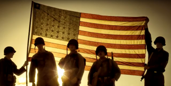 Picture shows multiple servicemembers in uniform silhouetted against the an American flag in the background.