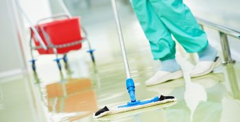 Picture of anhousekeeping Aide sweeping the floor