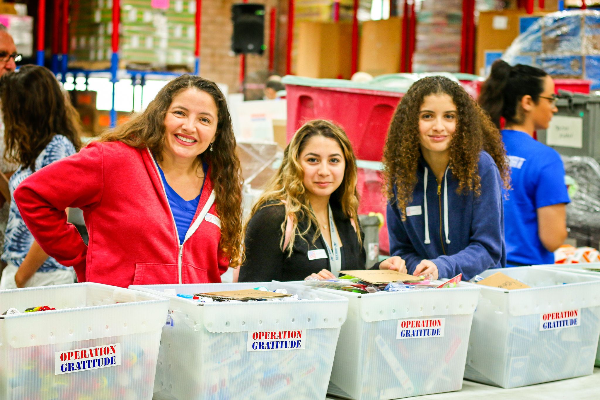Volunteers disseminating donations for care packages