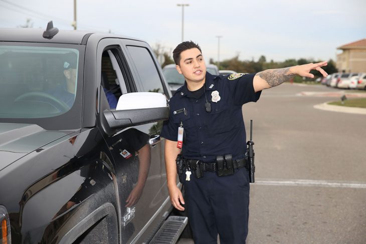 VA police officer Gustavo Garza instructs a Veteran motorist where to turn during the the Free Produce Distribution Drive-thru held December 12, 2018, at the parking lot of the VA outpatient clinic at McAllen, Texas. (U.S. Department of Veterans Affairs photo by Luis H. Loza Gutierrez)