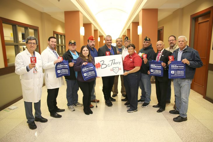 VA staff members pose for a group photo with officers from Veteran Service Organizations (VSOs) as a sign of solidarity in order to raise awareness about suicide prevention on January 23, 2019, at the VA outpatient clinic in Harlingen, Texas. The group posed with items that promote the free resources such as the Veterans Crisis Line and the website Maketheconnection.net, which were created to helping Veterans and families that may be going through a difficult situation, such as a Veteran contemplating suicide. Nationally-known VSOs such as the Disabled Veterans of America (DAV), the Veterans of Foreign War (VFW), the Marine Corps League and the American Legion were represented in the group photo along with local established VSOs such as the Veterans Memorial Project Committee and the Veterans Advisory Board for the city of Harlingen. (U.S. Department of Veterans Affairs photo by Luis H. Loza Gutierrez)