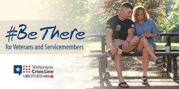 Picture shows two people sitting at an outdoor table looking at a phone. Text reads: #BeThere for Veterans and Servicemembers - Veterans Crisis Line 1-800-273-8255 - PRESS 1