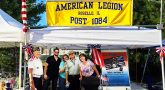 Pictures shows people standing under a canopy, text reads - AMERICAN LEGION - ROSELLE. IL - POST 1084