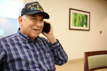 Retired Navy Senior Chief Petty Officer Joe Calvillo smiles after confirming an upcoming VA appointment with the help of a staff member from the call center for the VA Texas Valley Coastal Bend Health Care System (VCB) on February 8, 2019.