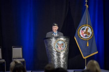 """Herschel """"Woody"""" Williams, Medal of Honor Recipient addresses crowd at the VA PX Symposium."""