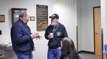 Two Veterans talking while having a cup of coffee