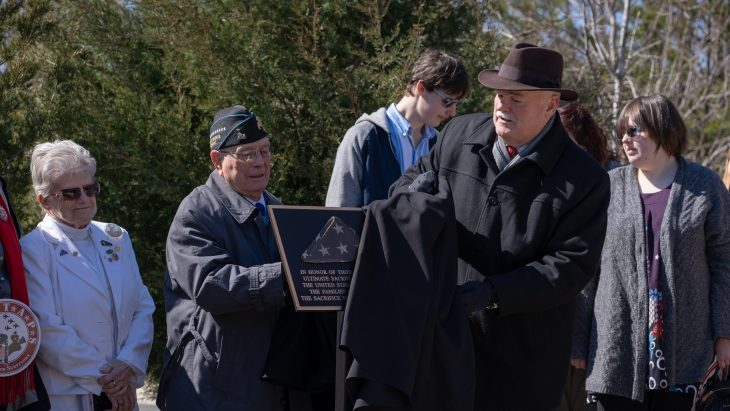 """Members from the National Cemetery Administration unveiled the first in a series of plaques dedicated to the fallen and their families during a ceremony, Tuesday, March 5, 2019, at Quantico National Cemetery. Under Secretary for Memorial Affairs, Randy C. Reeves  and  Medal of Honor recipient, Hershel """"Woody"""" Williams, were among the presenters."""