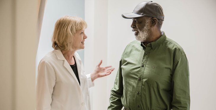 Healthcare professional and Veteran in a discussion.