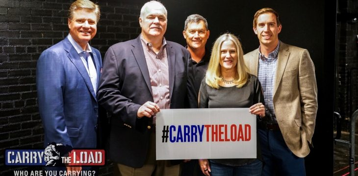 Group photo of Pete Delkus, Chief Meteorologist, WFAA; Randy Reeves, Under Secretary for Memorial Affairs; Todd Boeding, Carry The Load Board Member and Marine Veteran; Debbie Wright, Carry The Load Executive Director; Matt Fryman,