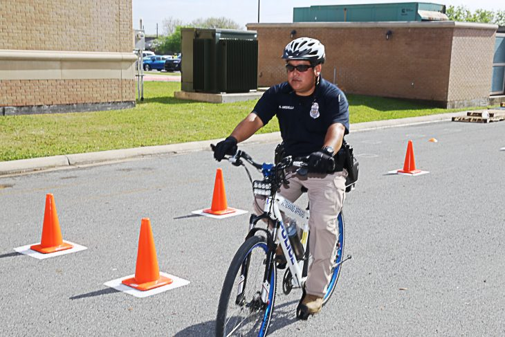 VA Police Officer Erick Medellin pedals to the final obstacle during a police bicycle training course. Medellin was one of two VA police officers who became the first in VA Texas Valley Coastal Bend Health Care System (VCB)'s history to complete certification for International Police Mountain Bike Association (IMPBA)'s course on February 15, 2019 at an obstacle training course set up bin the rear parking lot of the University of Texas Rio Grande Valley (UTRGV) Academic and Clinical Research Building in Harlingen, Texas. (VA photo by Luis H. Loza Gutierrez)