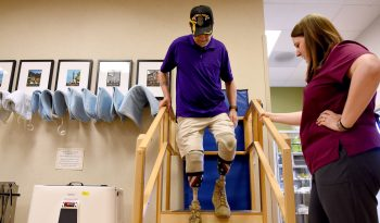 IMAGE of VA employee helping Veteran at North Texas VA