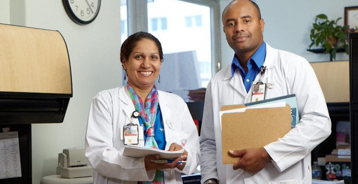 Two healthcare professionals in office