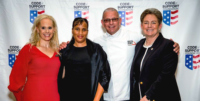 Picture of four people posing at a Code of Support Foundation ceremony