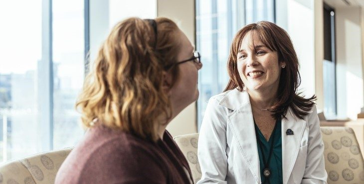 Healthcare provider talks with patient