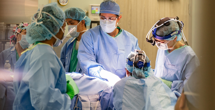 Surgeons perform an operation.