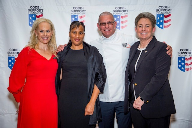 """Kristy Kaufmann, Code of Support Foundation's (COSF) Chief Executive Officer; Judith Foster, VA social worker at the Dublin, Ga VAMC and recipient of the COSF's """"Salute to Service"""" award; Celebrity Chief Robert Irvine; and Cassandra Law, Associate Chief Patient Care Services Officer."""