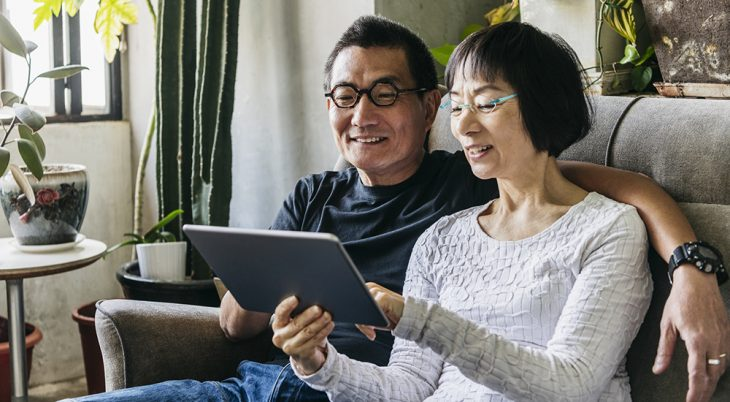 Man and woman looking at computer tablet screen
